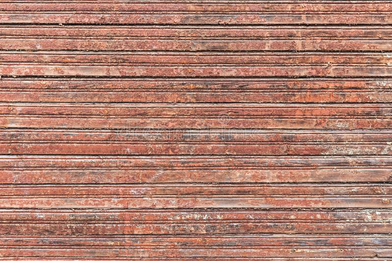 Brown barn wooden wall texture with peeling old paint stock photo