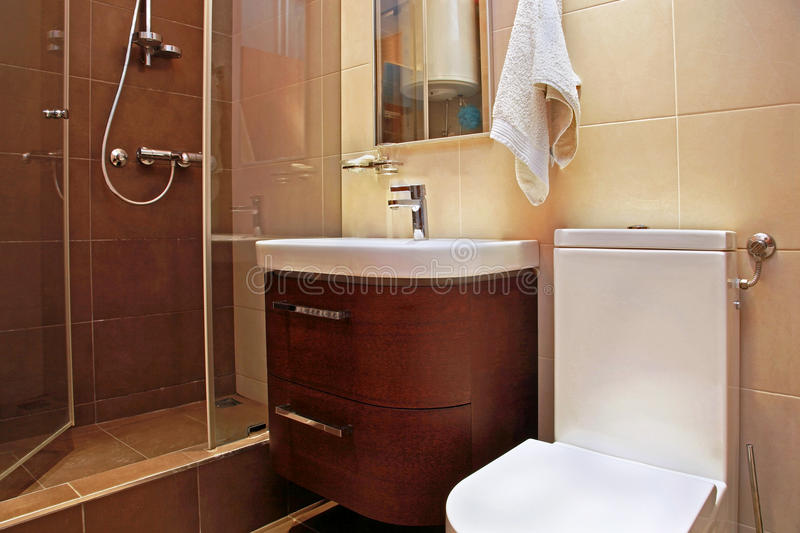 Brown bathroom small royalty free stock photography