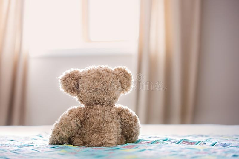 Brown Bear Plush Toy On Bed royalty free stock images