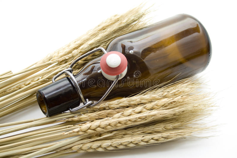 Brown Beer Bottle With Wheat Ears Stock Photography
