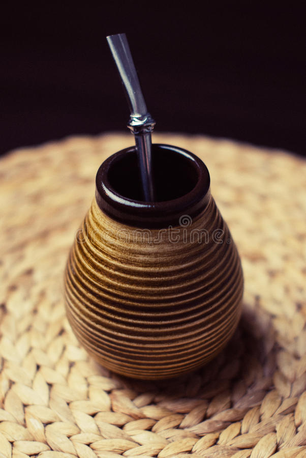 Brown and Beige Ceramic Container With Silver Inside on Brown Braided Textile stock images