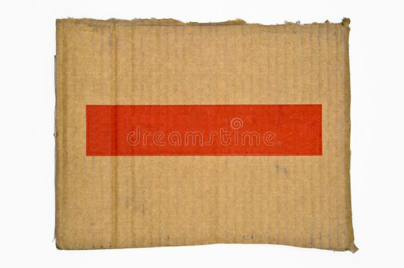 Brown and beige colored corrugated cardboard. Red banner. royalty free stock images