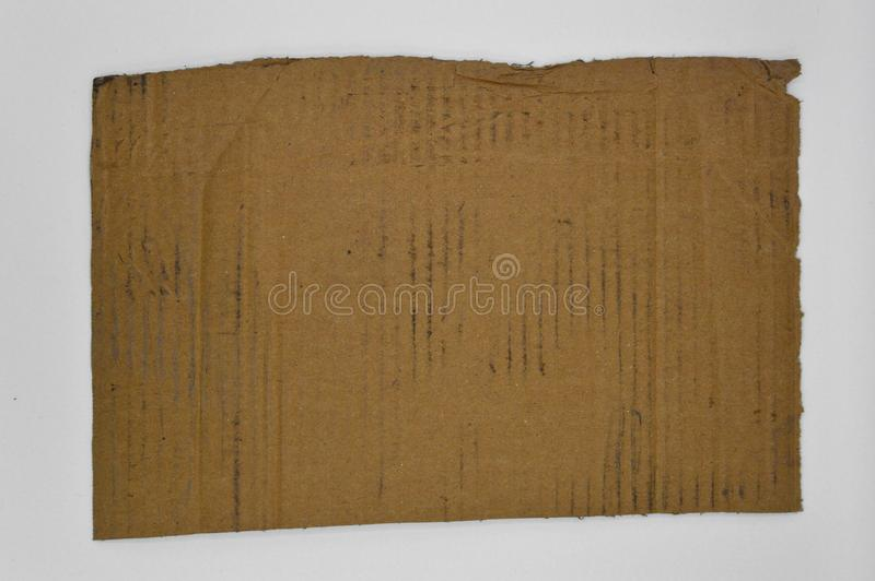 Brown and beige colored corrugated dirty cardboard royalty free stock photos