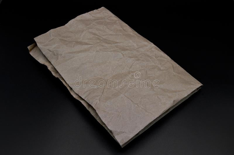 Brown and beige crumpled paper, cardboard. royalty free stock photography