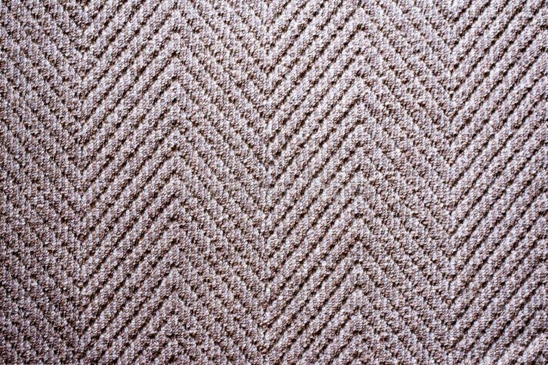 Brown beleuchten Gewebeteppich-Beschaffenheitshintergrund im Wohnzimmer stockbild