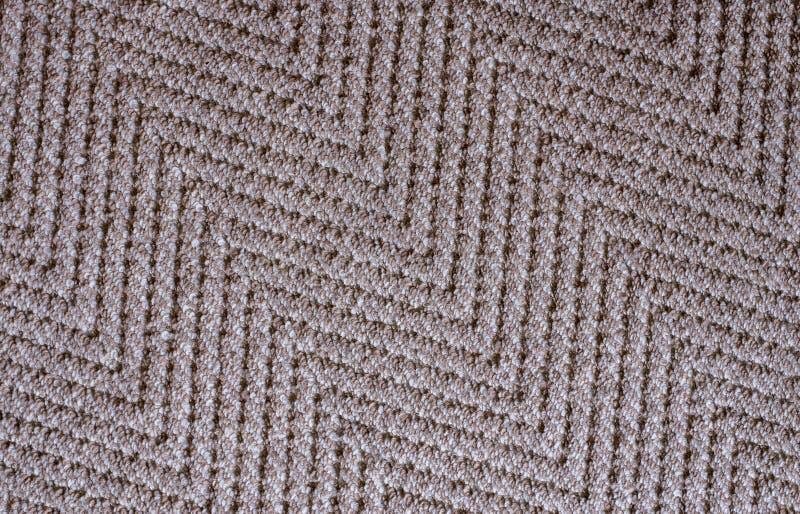 Brown beleuchten Gewebeteppich-Beschaffenheitshintergrund im Wohnzimmer stockfoto