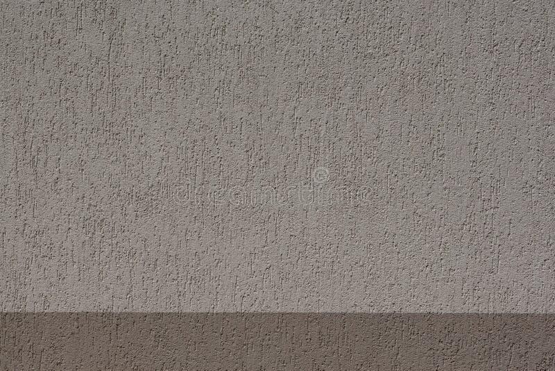 Brown betonowej ściany tła tekstura dla komponować obrazy stock