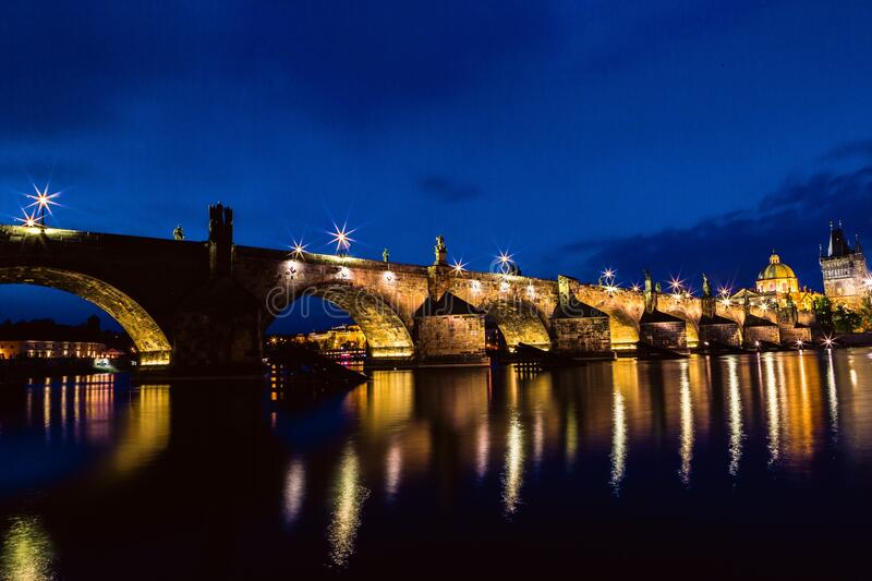 Brown and Black Concrete Bridge during Night royalty free stock image