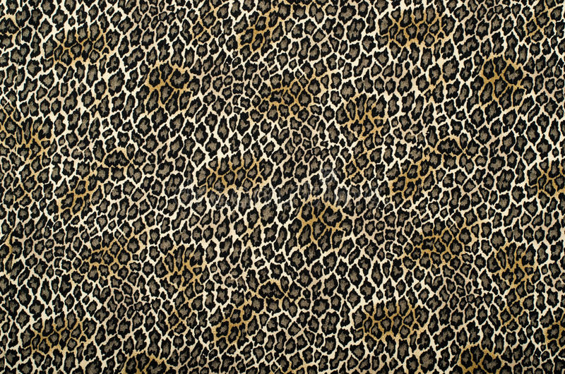 Brown and black leopard pattern. Animal leopard print as background stock images