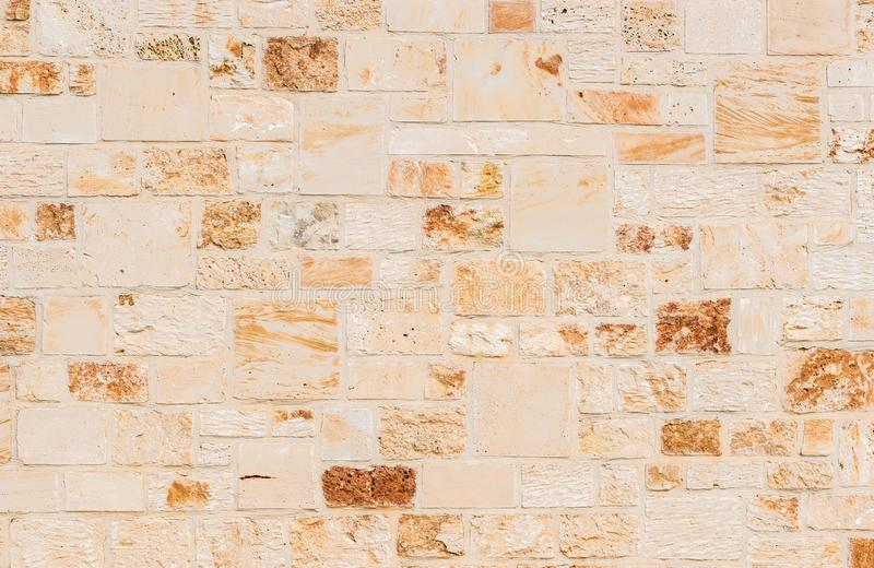 Brown block shaped nature stone wall texture royalty free stock photo