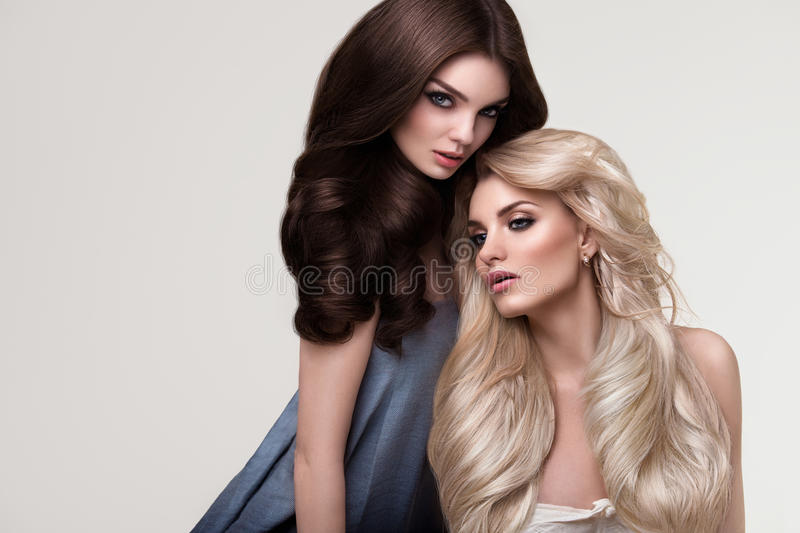 Brown and Blonde Hair. Portrait of Beautiful Womans with Long Ha stock photos