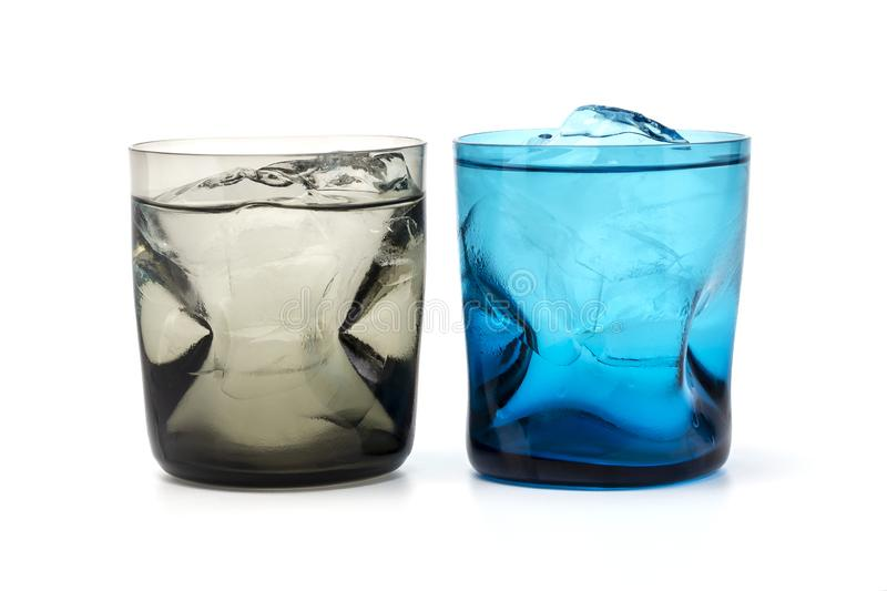 A brown and blue colour glass fill with fresh ice and water stock photos