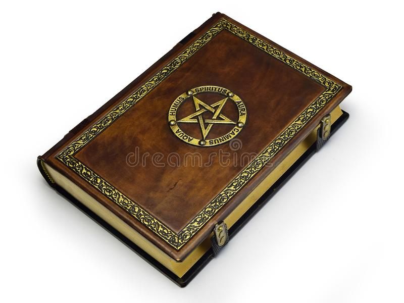 The brown book with gilded pentagram and names of the Five elements in Latin. The book is captured from the right side while lay down to the table stock images