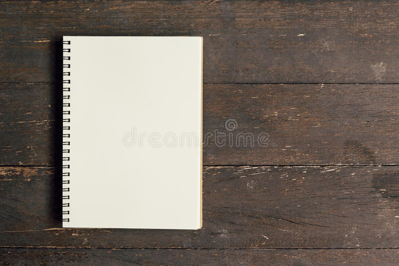 Brown book open on wood table background stock photos