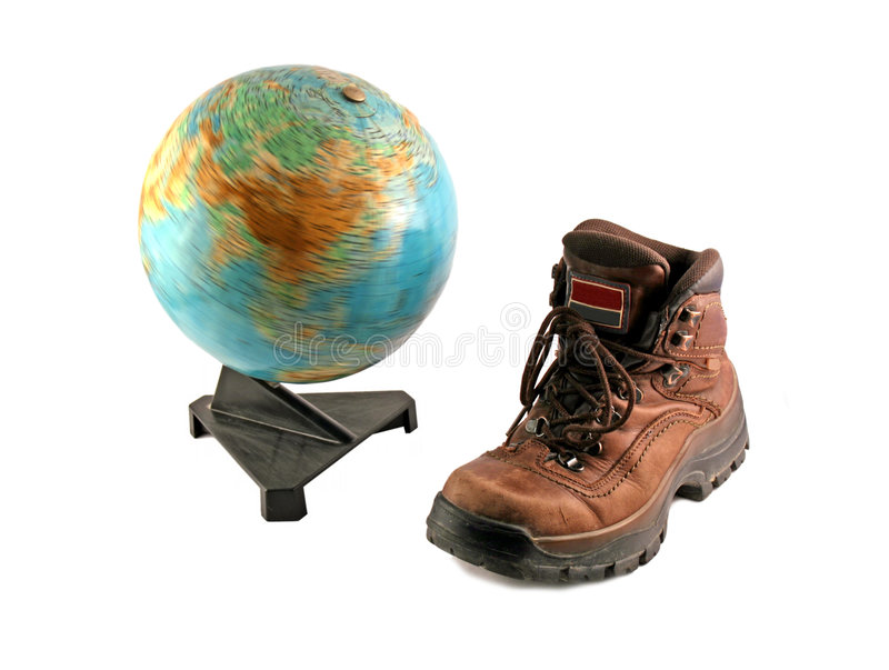 Brown boot next to a rotating globe stock photography