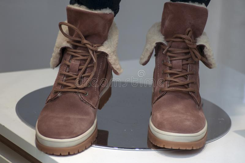 Brown boots in fashion store showroom for women royalty free stock photography