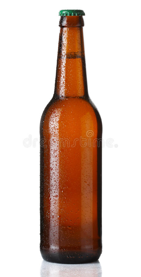 Brown bottle of beer with drops on white. Background stock photos