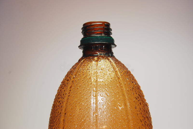 Brown bottle and drip royalty free stock image