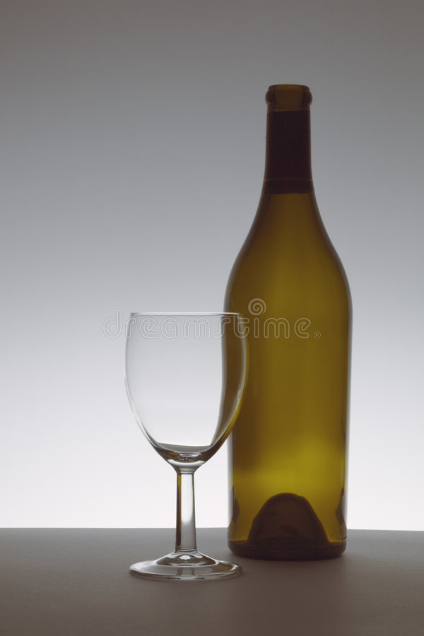 Brown bottle and glass royalty free stock images
