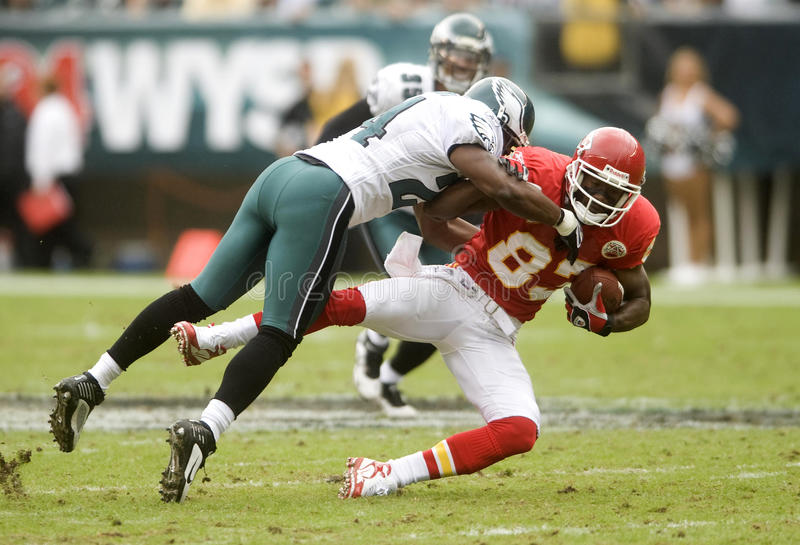 Brown Bradley. Philadelphia Eagles Sheldon Brown tackles Kansas City Chiefs Mark Bradley after a 6 yard gain in the first quarter of a 2009 game at Philadelphia royalty free stock images