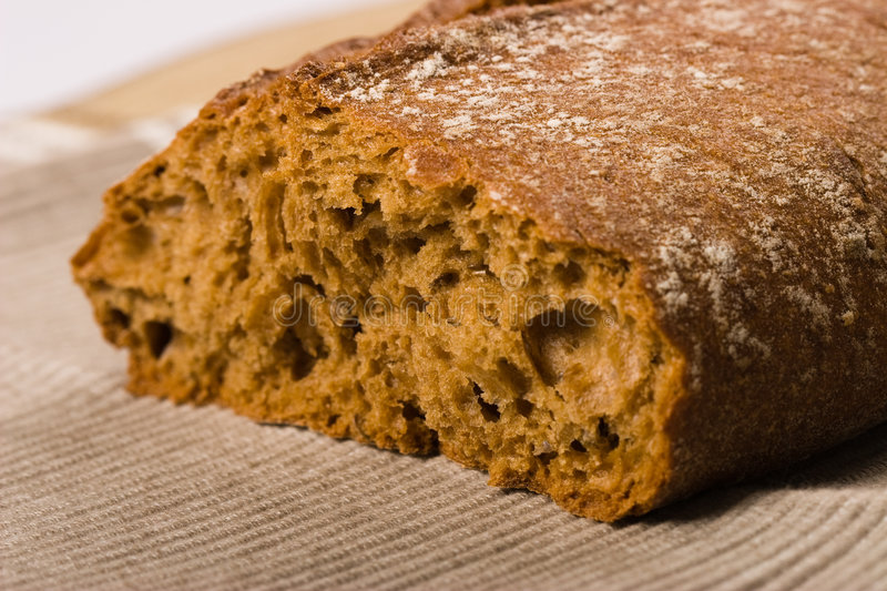 Brown bread. Fresh brown bread on a towel stock photography
