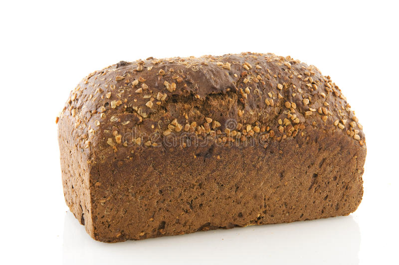 Brown bread with grain. Whole brown bread with grain on top stock images