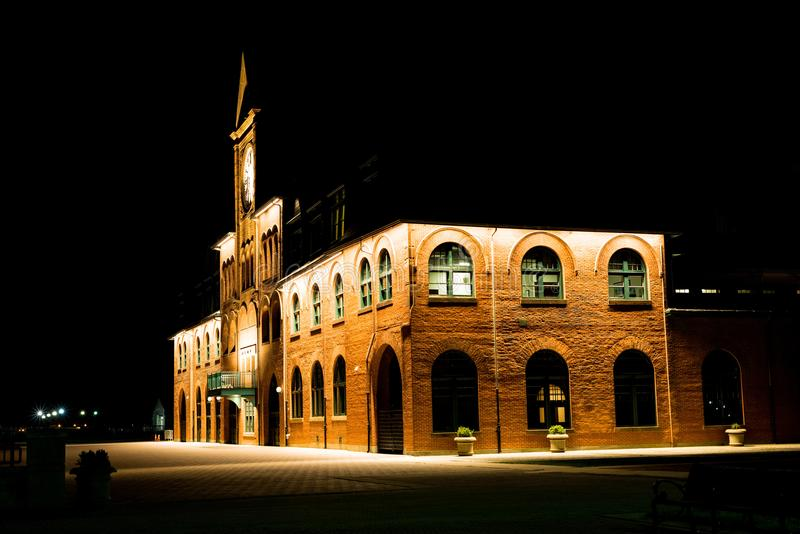 Brown Brick Building With Lights during Night Time stock photos