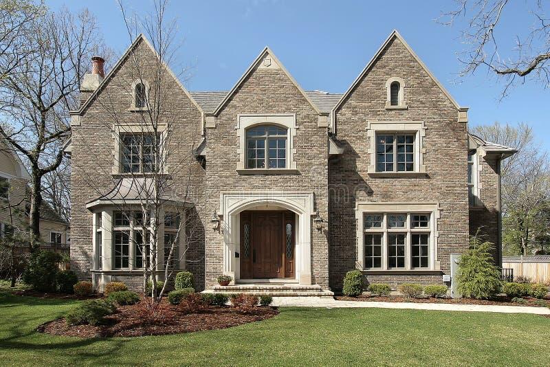 Brown brick luxury home stock image