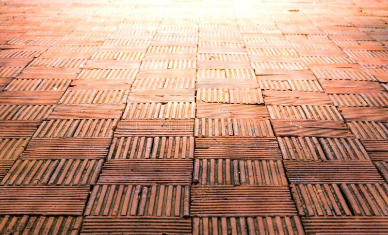 Brown brick pathway and beautiful sunlight at Tontang cafe, Lampang, Thailand. stock photography