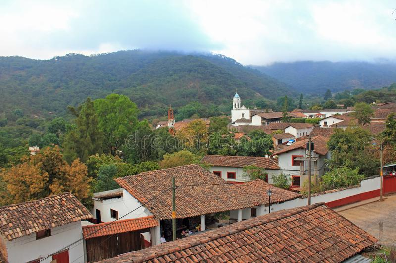 San Sebastian del Oeste, Jalisco, Mexico Cityscape. Brown brick roofs of historic houses in foreground, church and Sierra Madre mountains in background. San stock photo