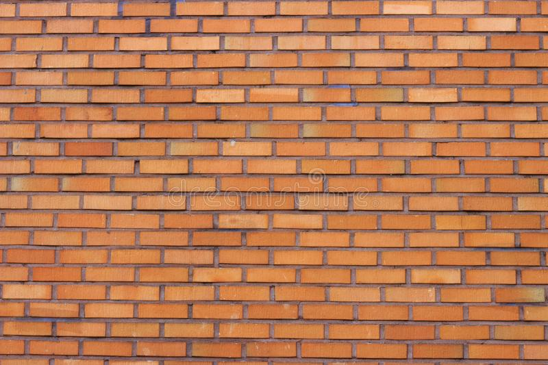 Brown brick wall close-up, texture, uneven surface, background royalty free stock photos
