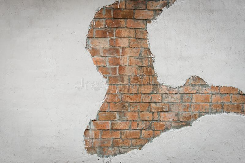 Brown brick wall with white painted concrete pattern. Useful for background design stock photo