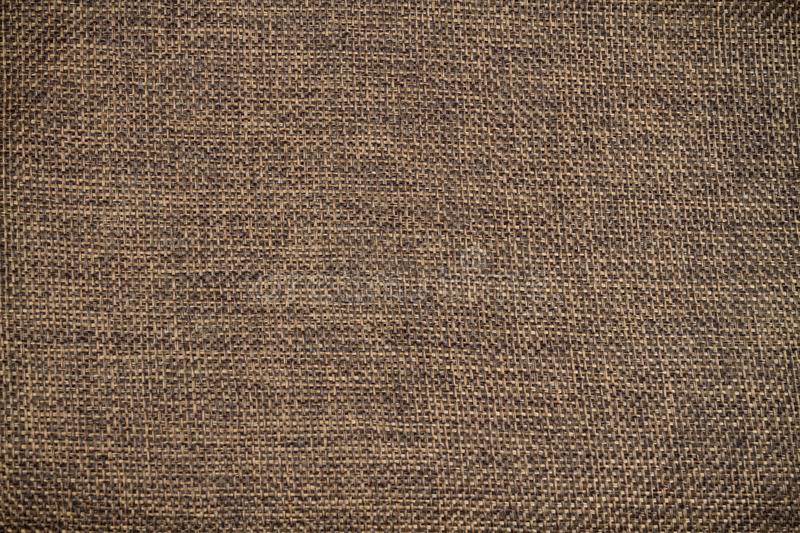 Brown calico fabric Texture. stock image