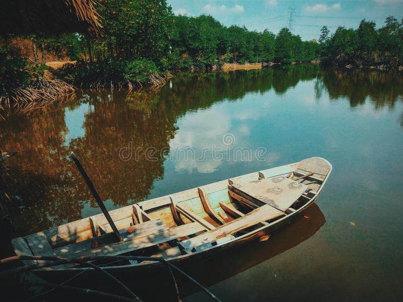 Brown Canoe Boat on Body of Water royalty free stock photos