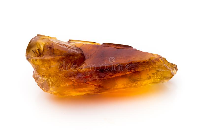 Brown caramelized sugar on white background. Brown caramelized lump cane sugar cube isolated on white background royalty free stock image