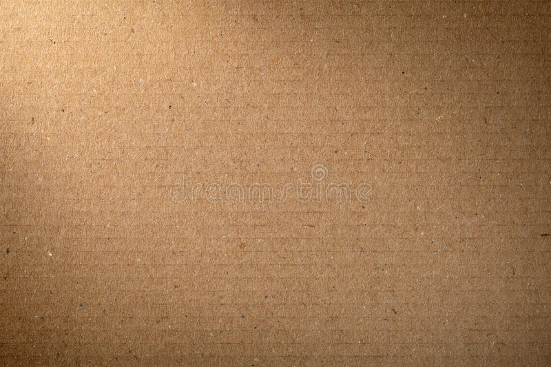 Brown Cardboard. Texture for background, lighting from the left corner stock images