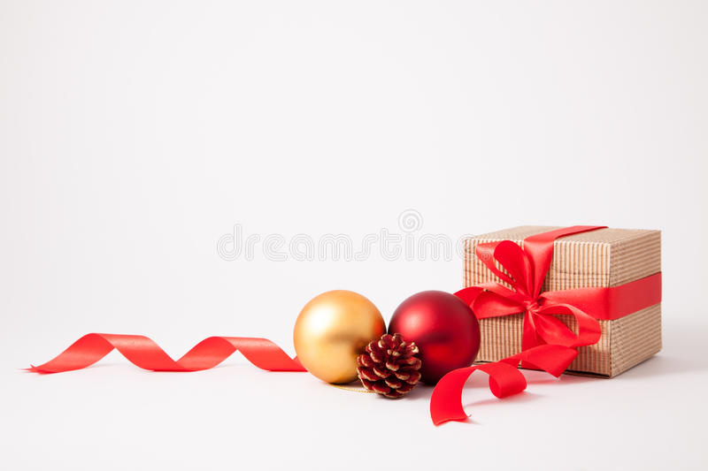brown cardboard box, bow and ribbon with christmas deco royalty free stock image