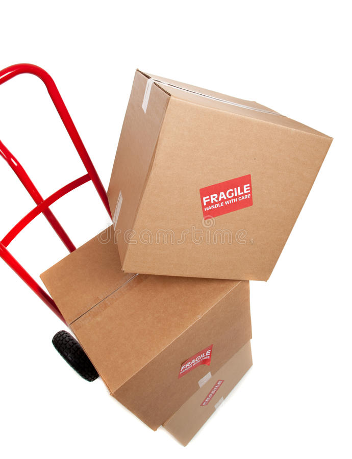 Brown cardboard moving box with a fragile sticker stock image
