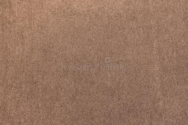 Brown carpet fabric flooring pattern surface texture. Close-up of interior material for design decoration background royalty free stock photos