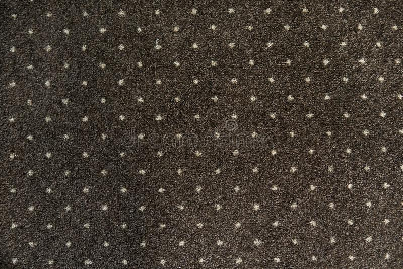 Brown carpet with a white dots texture. Indoor carpeting shoot in daylight. Brown carpet with a white dots texture. Indoor carpeting shoot in daylight royalty free stock images