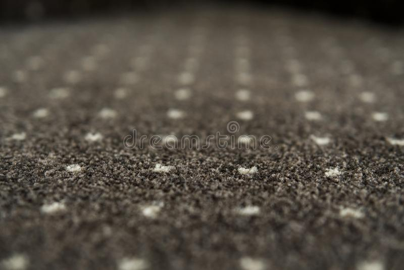 Brown carpet with a white dots texture. Indoor carpeting shoot in daylight. stock photos