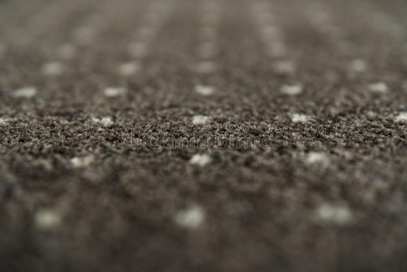 Brown carpet with a white dots texture. Indoor carpeting shoot in daylight. royalty free stock photo
