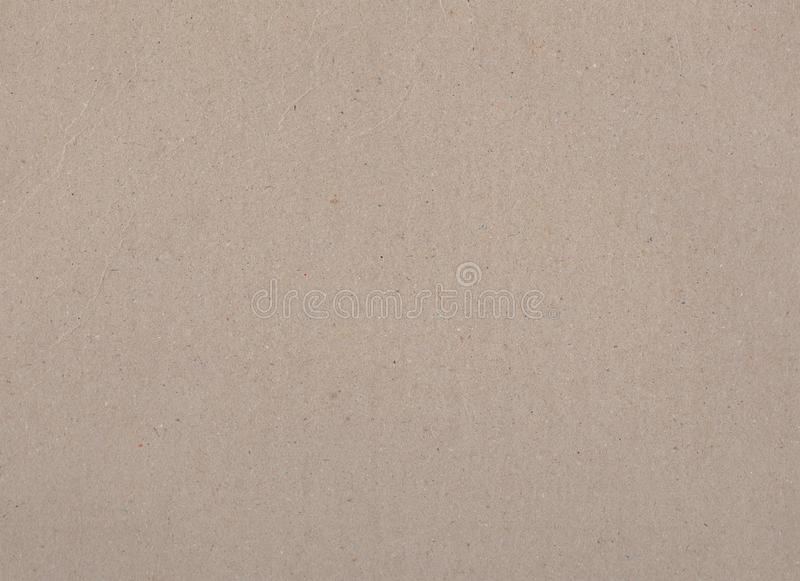 Brown carton or craft paper closeup texture. Cold tone beige cardboard horizontal photo. Textured crafted paper mockup royalty free stock images