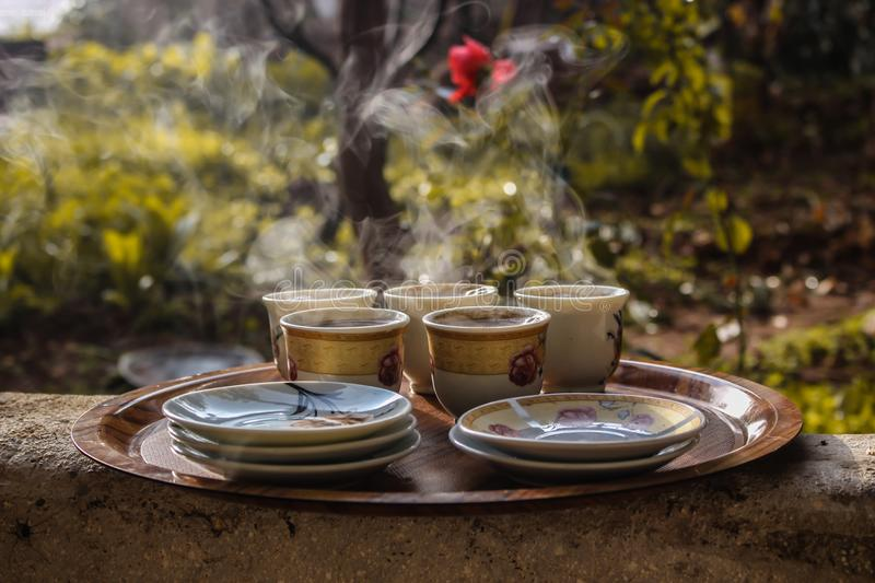 Brown Ceramic Teacups Beside Saucers on Brown Serving Plate stock photography