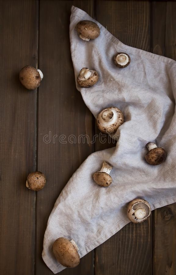Brown champignons on rustic background royalty free stock photo