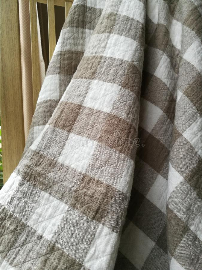 Brown checkered cotton blanket royalty free stock images