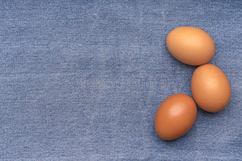 Brown chicken eggs on a blue denim royalty free stock photo