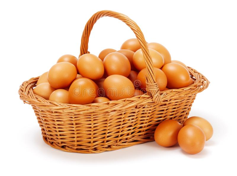 Brown chicken eggs in basket stock photos