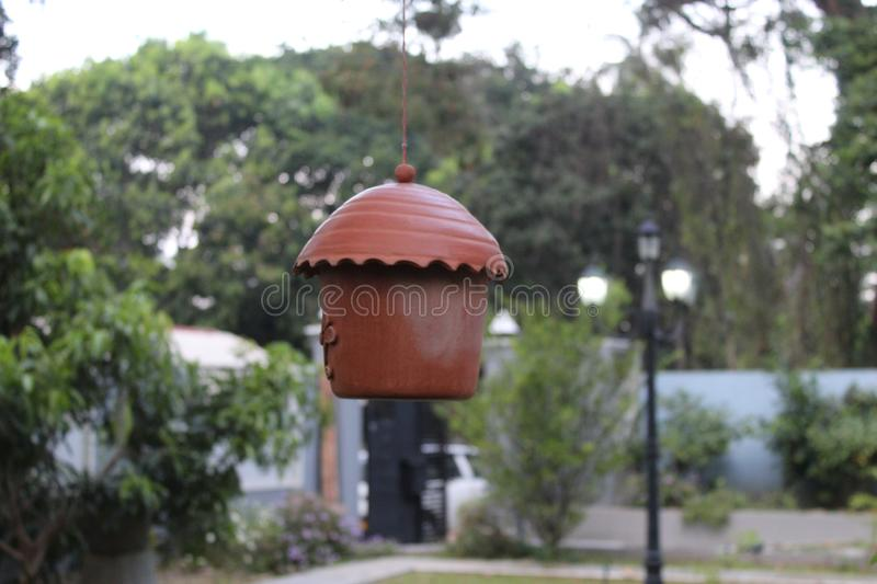 Brown clay bird home stand alone stock image