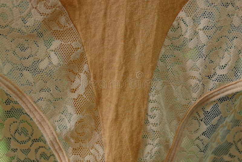 Brown fabric texture from a piece of crumpled clothes. Brown cloth background of a piece of crumpled clothes royalty free stock photos